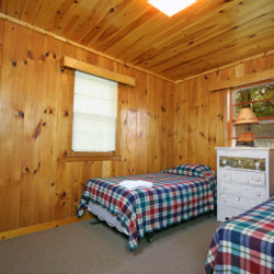 Woodlands lake home cabin bedroom at Adventure North Resort