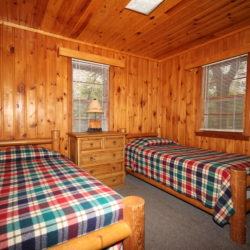 Bedroom in the woodlands lake home cabin on Leech Lake
